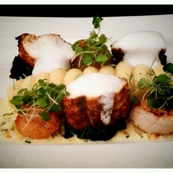 Tandoori roasted monkfish with a vanilla mash, sautéed scallops, buttered greens, brunoise cream sauce and coconut foam - £17.95