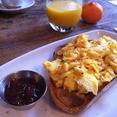 Scrambled Eggs on Sourdough with Tomato Kasundi Relish. + OJ and my own Orange.