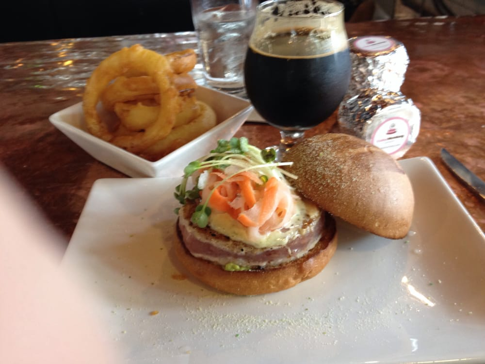 My awesome Ahi Tuna Burger, tempura onion rings, stout beer and ...