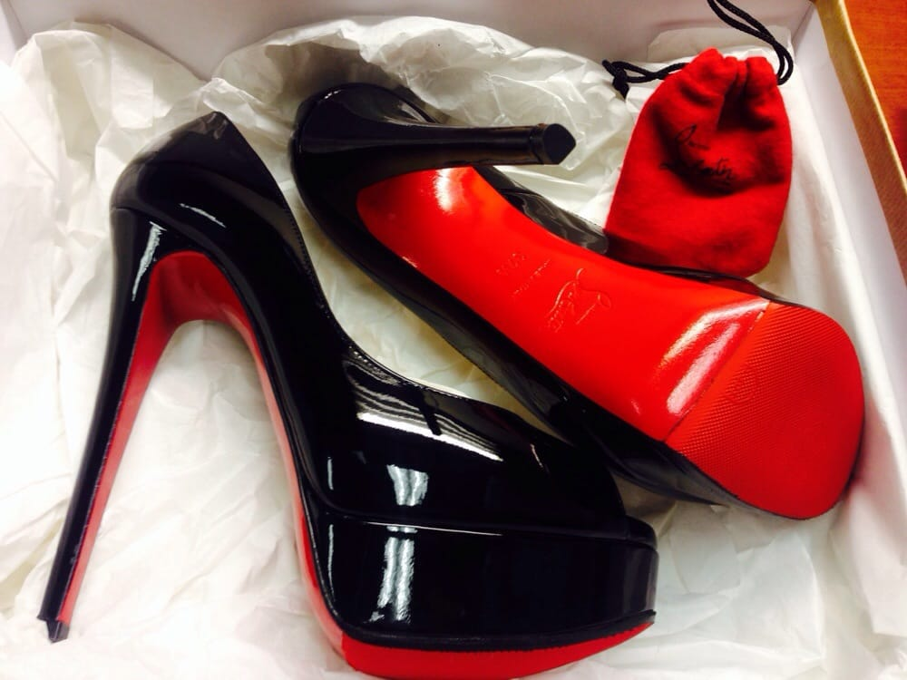 Bottom/side view of Topy red bottom shoe protector for new pair of ...