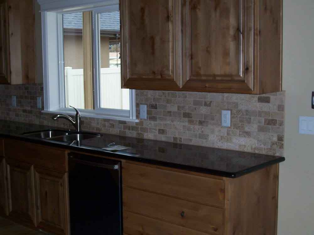 black galaxy counters and 2x4 noce tumbled travertine
