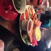 Café Jade - Paris, France. Brunch Jade: saumon sur sa tranche de pain,  sauce barbecue, omelette, tomate mozzarella, pommes rösti , aiguillettes panés