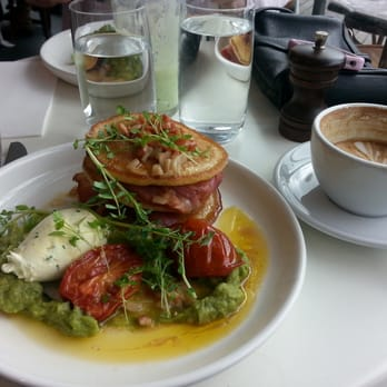 ... pancakes: bacon layers, smashed avo, lime creme fraiche and tomatoes