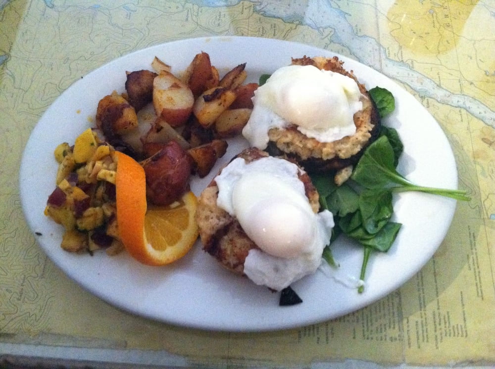 Crab cakes and spinach on an English muffin, topped with poached eggs ...