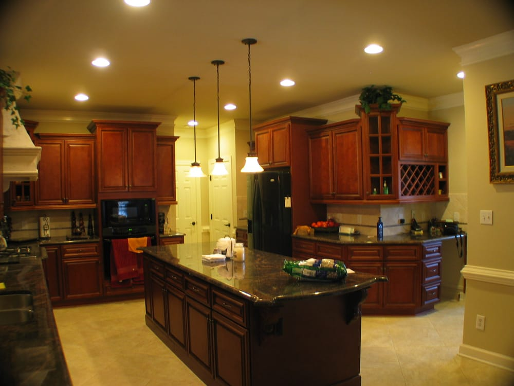 Lenox mocha kitchen cabinets with granite counters yelp for Carriage house kitchen cabinets