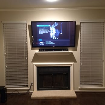 60 quot tv and sound bar mounted over a fireplace very clean and sleek