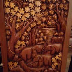 The wooden chairs hand carved from…