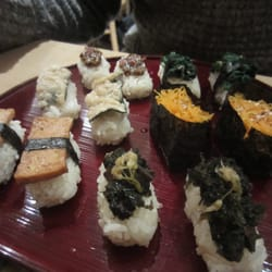 Vegan sushi: miso/seaweed, spinach, carrot, tempura nori, seaweed and fried tofu.
