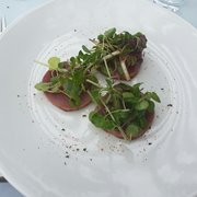 Lunch starter : Prepared tuna, Granny Smith apple, radish and dandelion salad