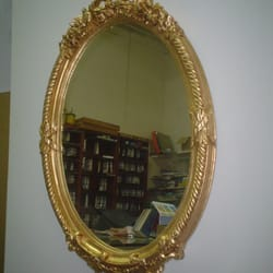 Espejo dorado ovalado 1