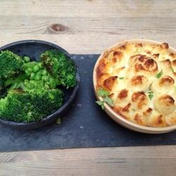 Cottage Pie with broccoli and peas on…
