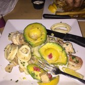 Waiter's Bar & Grill - San Juan, Puerto Rico, Puerto Rico. Seafood stuffed avocado... Very tasty and garlic sauce however I'm not a fan of the grouper