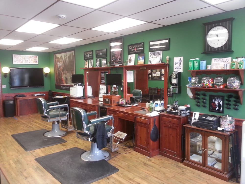 Foleys Barber Shop has two Barber stations with 19 inch televisions ...