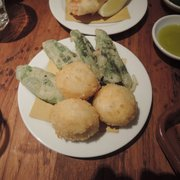 Mozzarella balls and sage leaves stuffed with anchovies