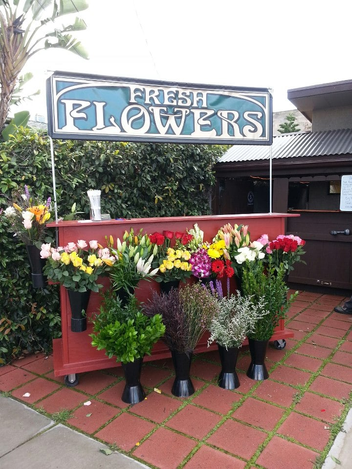 A Friendly Open Air Flower Stand Located In North Park