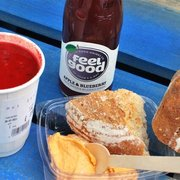 Beetroot & butterbean soup, red hummus, hunk of bread,  apple &  blueberry juice.