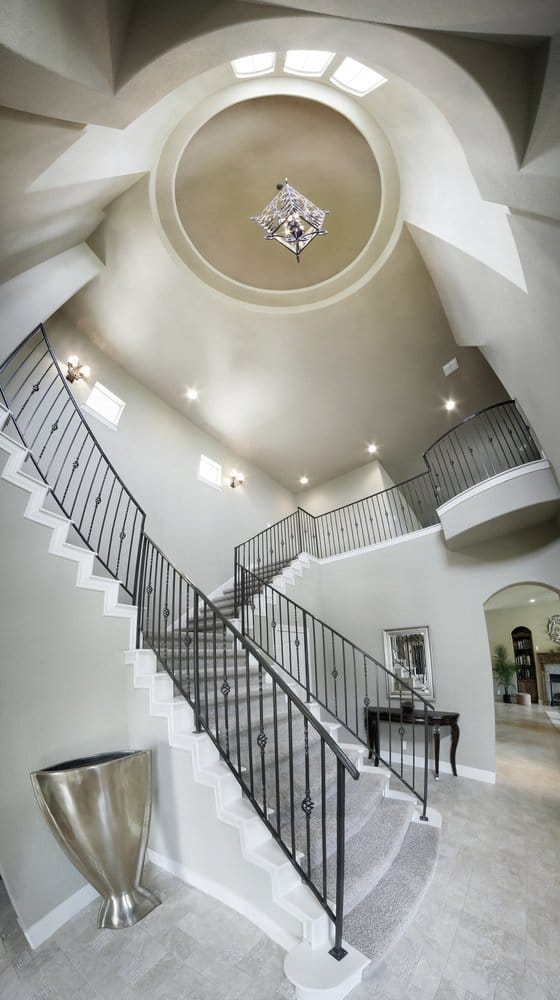 Foyer Stairs Reviews : Dramatic foyer and entryway featuring split staircase yelp