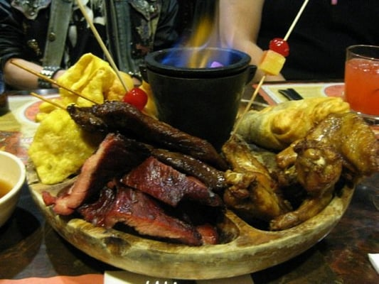 Pu Pu Platter: served native style with a burning blue ...