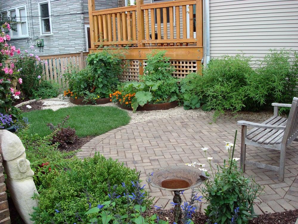 Back yard clay paver patio urban farming raised beds for Urban garden design