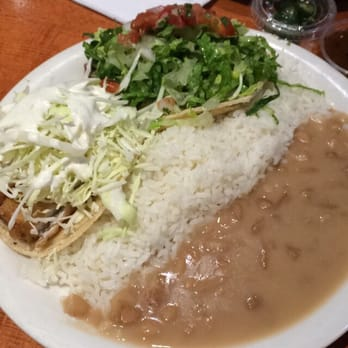 ... and carne asada, with butter rice and pinto beans. Pretty big plate