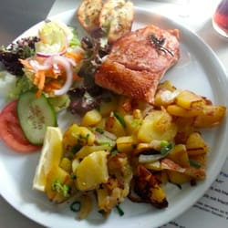 Grilled salmon with side salad, potatoes…