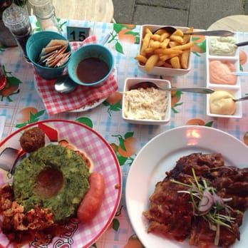 L: hotchpotch with spinach, sausage and meatball. Extra sauce. R: mama's ribs w chips & dips and sauerkraut. €15 each! Yum!