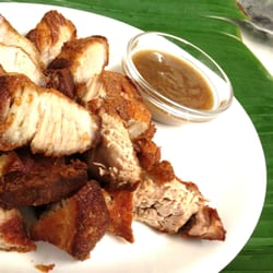 Lechon Kawali served with Mang Tomas. ( Marinated deep fried belly pork )