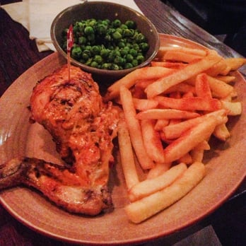 1/4 hot peri-peri chicken with peri-peri chips and mushy peas