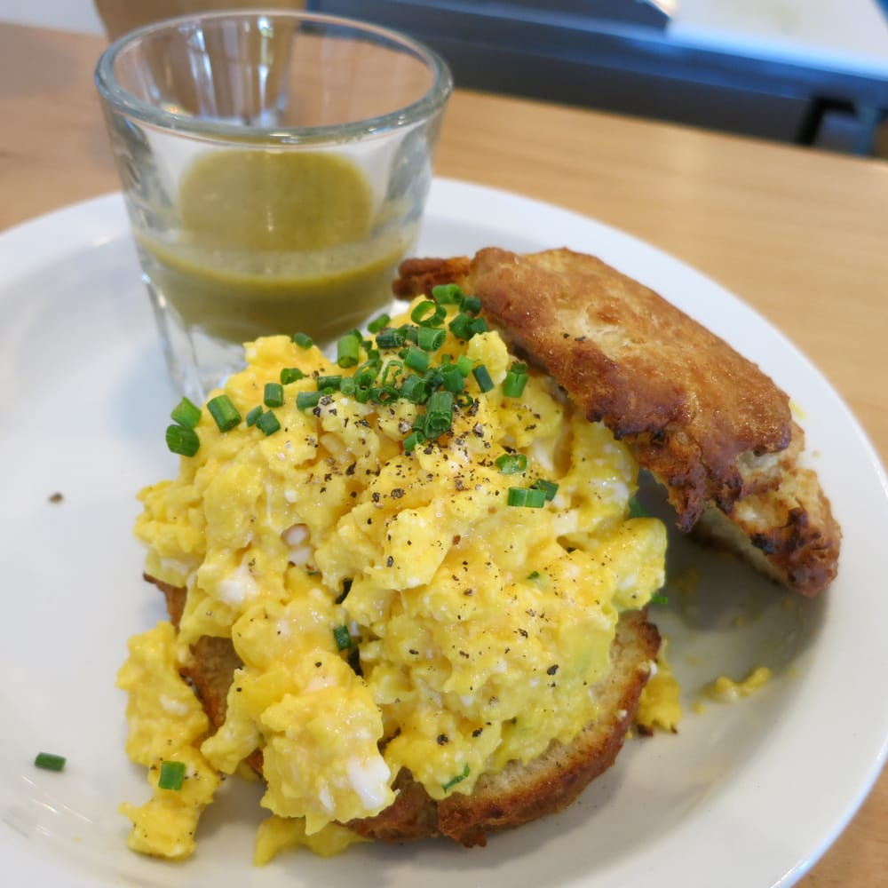 ... Scrambled Eggs, Avocado, Housemade Biscuit and Tomatillo Hot Sauce