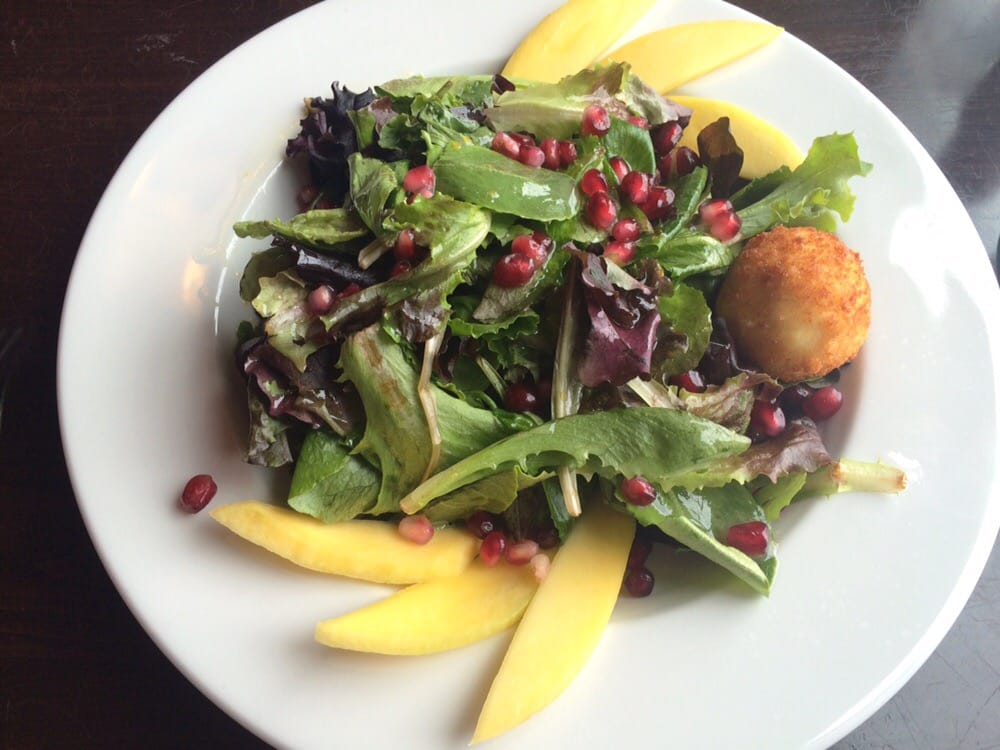 ... States. Warm goat cheese salad with mango and pomegranate seeds