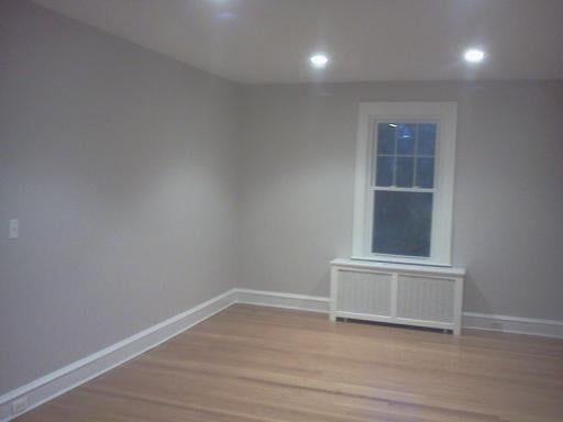 Battleship grey with super white trim in a living room in for Grey walls white trim