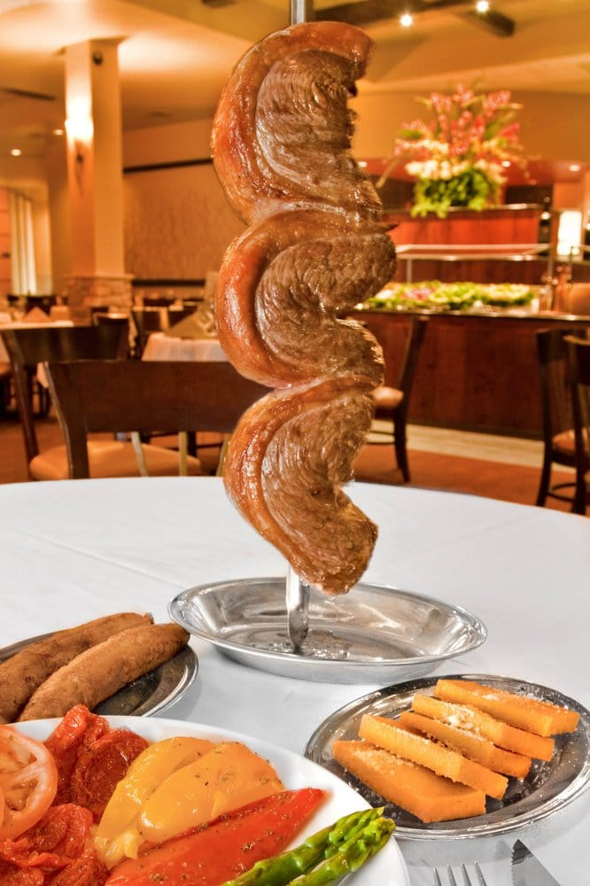 Brasa Steakhouse is an authentic Brazilian rodizio style restaurant. Rodizio is a method of serving fire-roasted meat that originates in Southern Brazil.