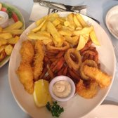Seafood platter with delicious calamari, fish, chips and tar tar sauce