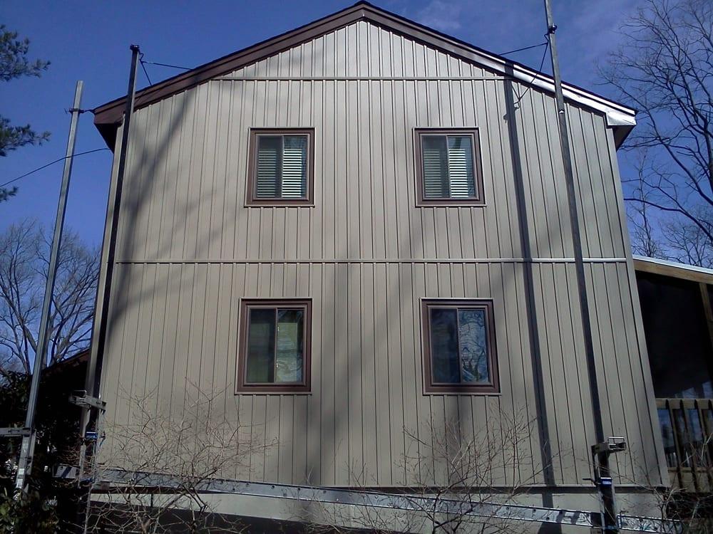 Board&Batten Vertical Siding (tuscan clay), brown trim | Yelp