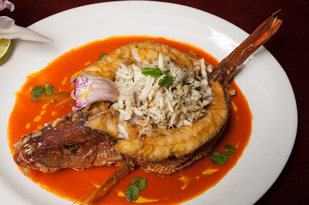 ... ) Coconut Pineapple Rice, Crab Meat, Lobster Enchilada Criolla Sauce
