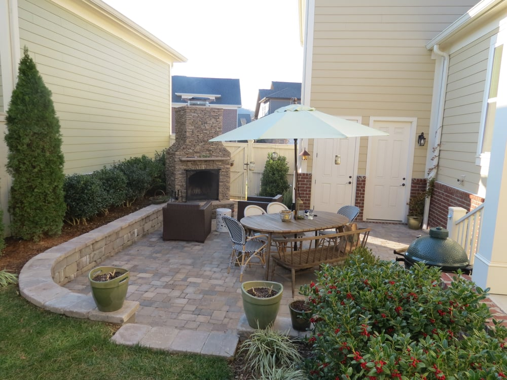 Outdoor living space with a natural stone fireplace for Living outdoor wall