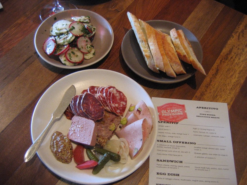 Olympia Provisions - Portland, OR, États-Unis. house charcuterie platter and shaved turnips salad