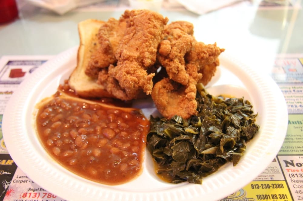 Fried catfish plate with baked beans and collared greens. | Yelp