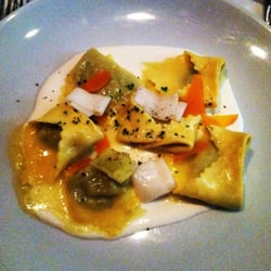 Herb ravioli burrata cream with egg yolk bottarga.