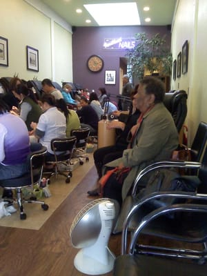 Cute tastefully decorated nail salon packed on a rainy for A perfect 10 nail salon rapid city
