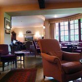 Pheasant Inn - The larger of the two residents' lounges. It has an enormous wood-burning stove and plenty of comfortable seats. - Cockermouth, Cumbria, United Kingdom