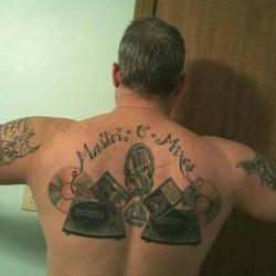 Looking glass tattoo gallery tattoo topeka ks for Looking glass tattoos