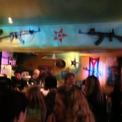 The bar inside Cubana - how can you not love a place that has actual AK-47's for wall decorations?