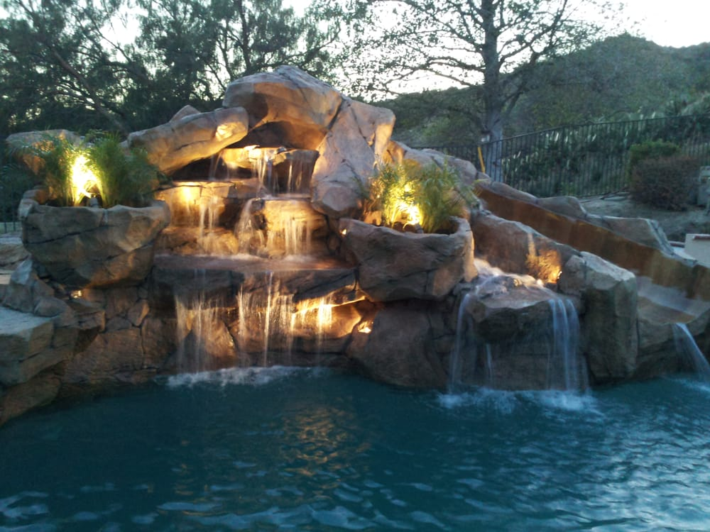Rock waterfalls with slide added to swimming pool yelp for Swimming pool waterfalls pictures