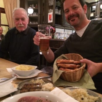 Dining with a local gentleman. Beer and pretzels in hand. Sausages, tongue, and sauerkraut ready to be devoured!