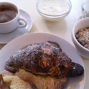 Almond croissant, yoghurt, muesli, coffe