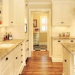 Olson & Jones Construction - Remodeled kitchen with slab stone