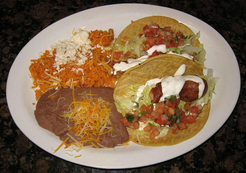 ... citrus-marinaded pulled pork) Taco and Ensenada Shrimp Taco with beans