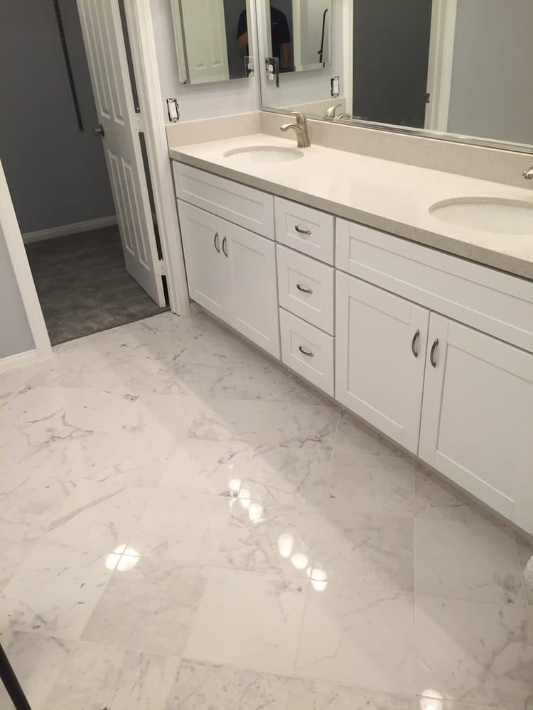 Vanity Cabinets And New Quartz Countertop And Polished Porcelain