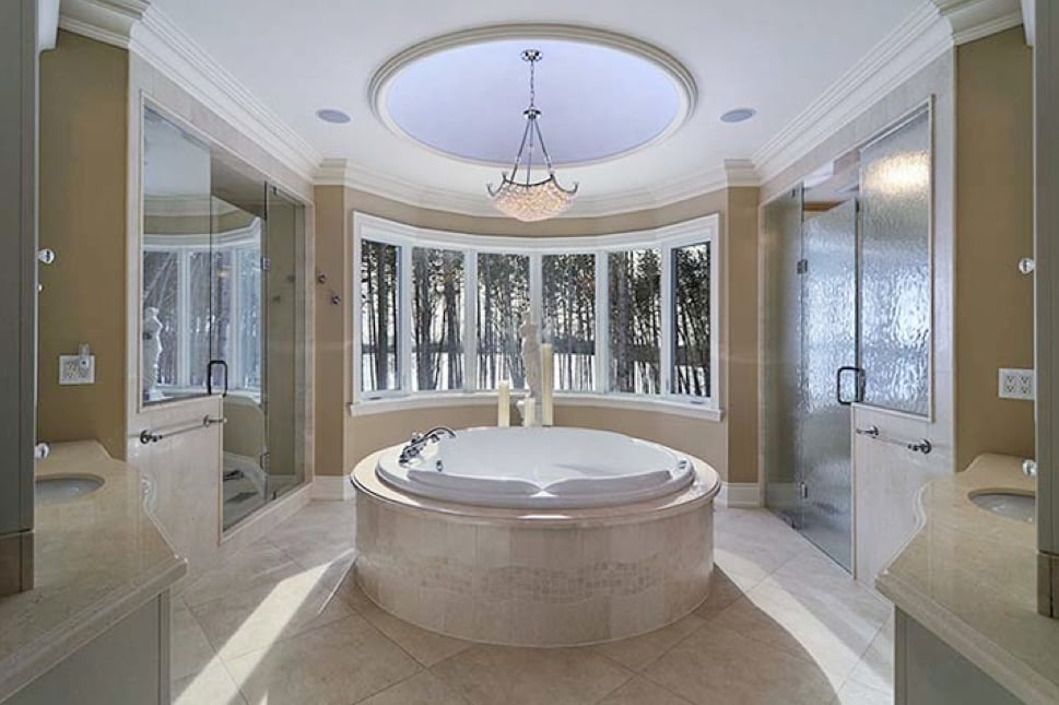 Circular Jacuzzi Tub with infinite mosaic wave tile on tub surround ...
